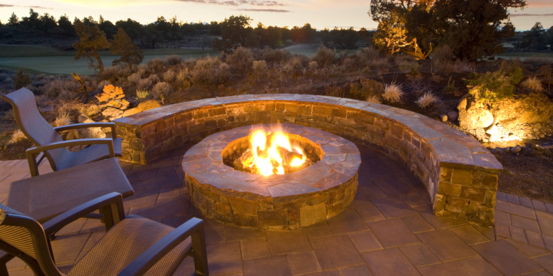 Outdoor fire pits offer many practical uses