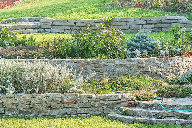 Make Your Sloped Yard Useful with Retaining Walls